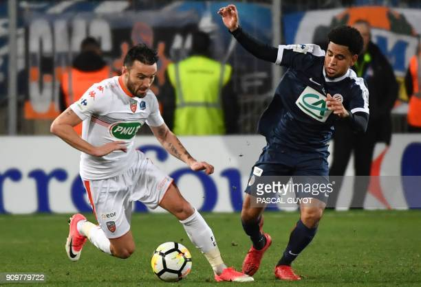 Lorient's French midfielder Gael Danic vies with Montpellier's South African forward Keagan Dolly during the French Cup round of 16 football match...