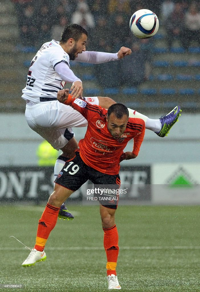 Lorient's French midfielder Romain Philippoteaux (R) vies with Bordeaux's Serbian defender Milan Gajic (L) during the French L1 football match between Lorient and Bordeaux at Moustoir Stadium in Lorient, western France, on October 4, 2015. Lorient won the match 3-2.