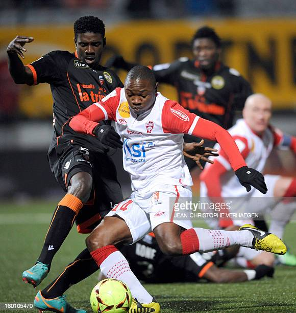 Lorient's Gabonese defender Bruno Ecuele Manga fights for the ball with Nancy's Cameroonian forward Paul Alo'o Efoulou during their French L1...