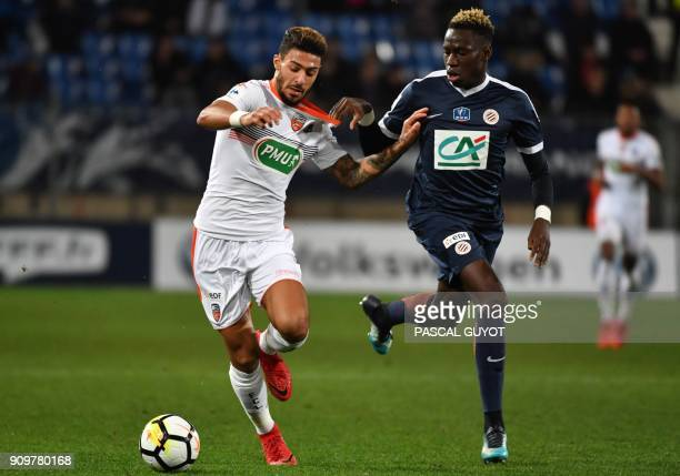 Lorient's Gabonese forward Denis Bouanga vies with Montpellier's Frenh midfielder Junior Sambia during the French Cup round of 16 football match...