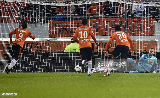 Lorient's Ghanaian forward Abdul Majeed Waris scores a penalty kick during the French L1 football match between Lorient and Dijon on January 28 2017...