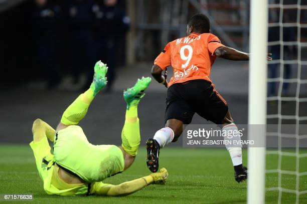 Lorient's Ghanaian forward Abdul Waris scores a goal during the French L1 football match between Lorient and Metz on April 22 2017 at the Moustoir...