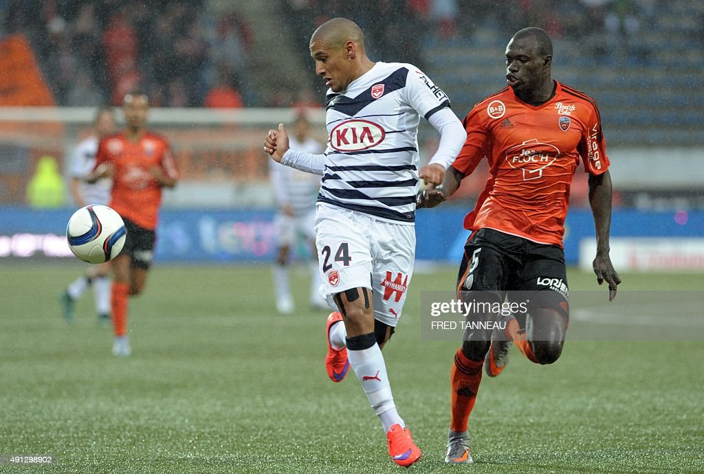 Lorient's midfielder Zargo Toure (R) vies with Bordeaux's French striker Wahbi Khazri (L) during the French L1 football match between Lorient and Bordeaux at Moustoir Stadium in Lorient, western France, on October 4, 2015. Lorient won the match 3-2.