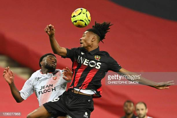 Lorient's Nigerian forward Terem Moffi vies with Nice's French midfielder Khephren Thuram during the French L1 football match between OGC Nice and FC...