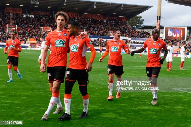 Lorient's players celebrate a goal of Lorient's French midfielder Sylvain Marveaux during the French Cup football match between Lorient and Brest on...