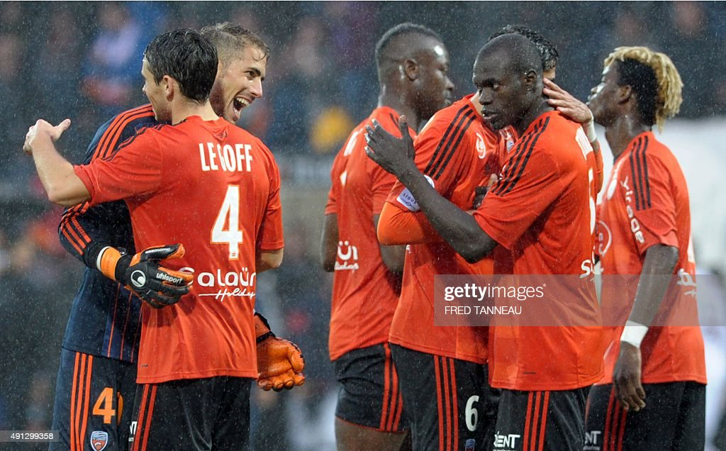 Lorient's players celebrate after the French L1 football match between Lorient and Bordeaux at Moustoir Stadium in Lorient, western France, on October 4, 2015. Lorient won the match 3-2.