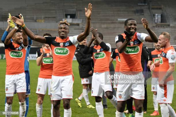 Lorient's players celebrate after winning the French Cup football match match between Angers and Lorient , on January 7 in Raymond Kopa stadium, in...
