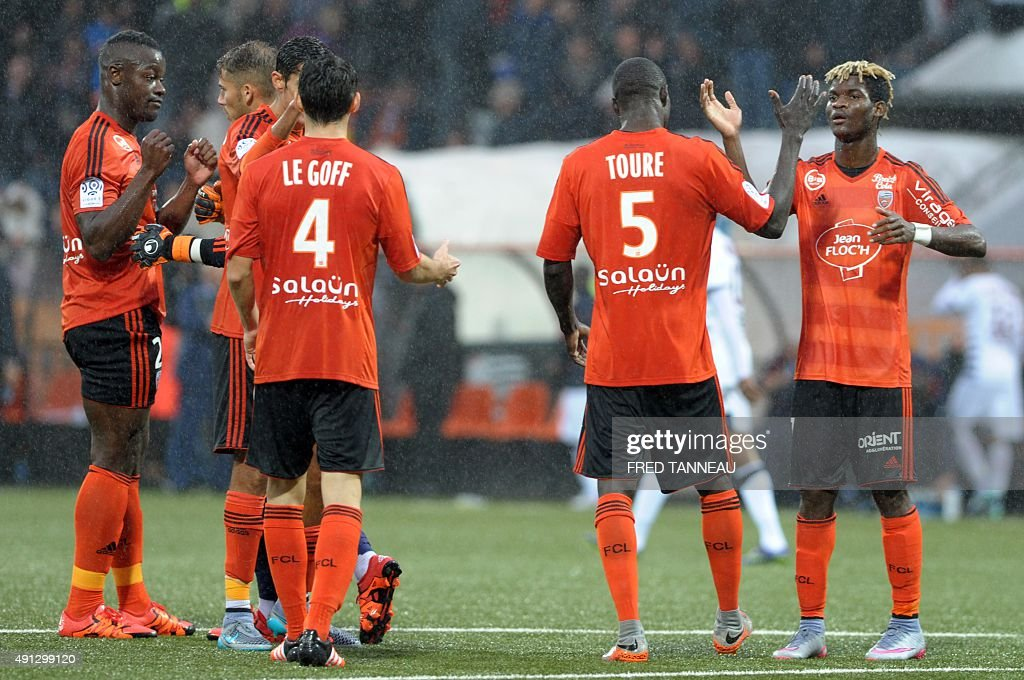 Lorient's players celebrate during the French L1 football match between Lorient and Bordeaux at Moustoir Stadium in Lorient, western France, on October 4, 2015. Lorient won the match 3-2.