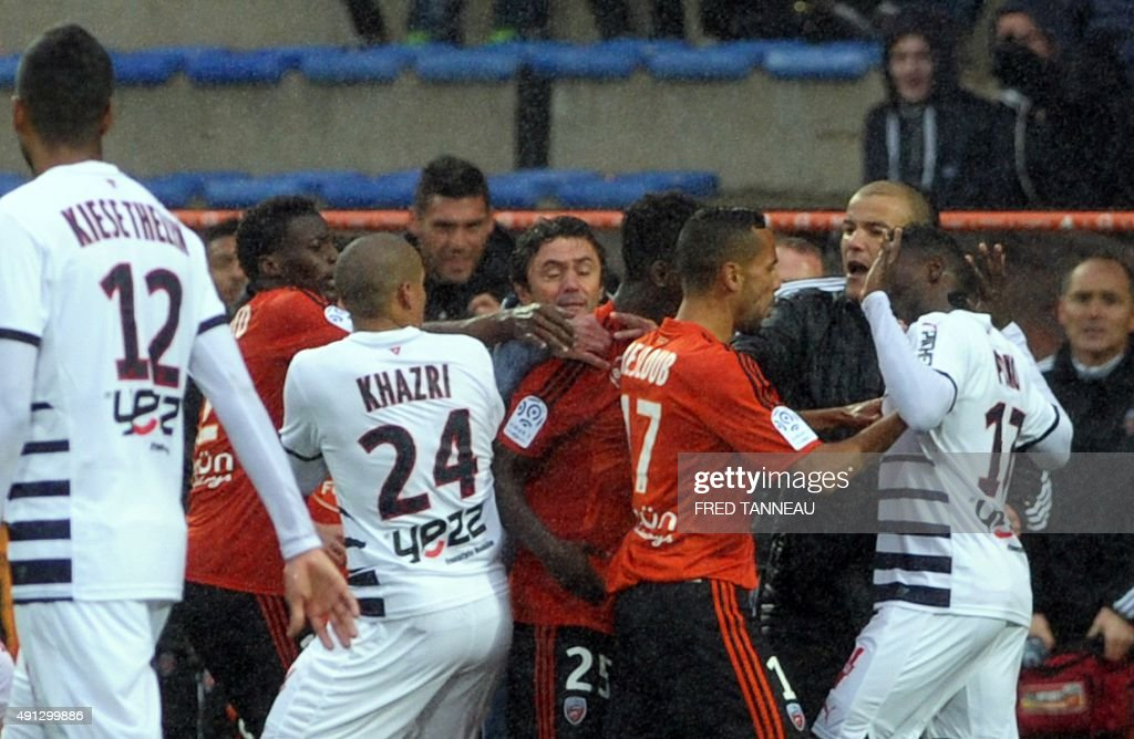 Lorient's players react at the expulsion of Lorient's French defender Francois Bellugou during the French L1 football match between Lorient and Bordeaux at Moustoir Stadium in Lorient, western France, on October 4, 2015. Lorient won the match 3-2.