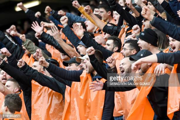 Lorient's supporters cheer during the French Cup football match between Lorient and Brest , on January 5 at the Moustoir stadium in Lorient,...