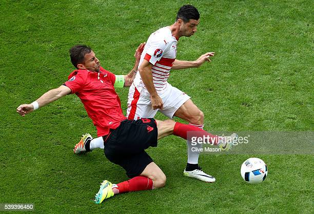 Lorik Cana of Albania fouls Blerim Dzemaili of Switzerland resulting in an yellow card during the UEFA EURO 2016 Group A match between Albania and...
