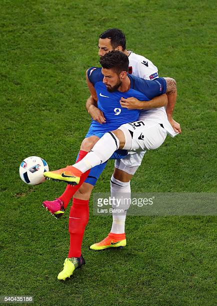Lorik Cana of Albania is helf off from Olivier Giroud of France during the UEFA EURO 2016 Group A match between France and Albania at Stade Velodrome...