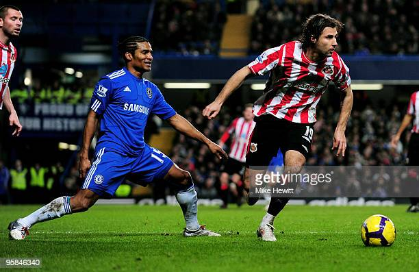 Lorik Cana of Sunderland goes past the challenge from Florent Malouda of Chelsea during the Barclays Premier League match between Chelsea and...