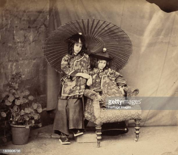 Lorina and Alice Liddell in Chinese Dress, 1860. Artist Lewis Carroll. .