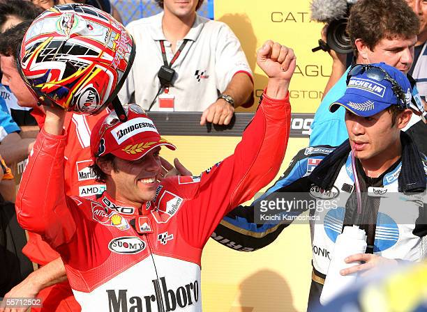 Loris Capirossi of Italy and Makoto Tamada of Japan celebrate after winning the Japanese MotoGP at the Motegi Twin Ring curcuit on September 18 2005...
