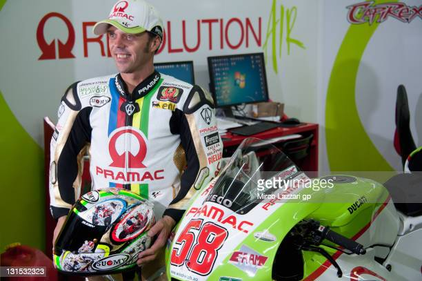 Loris Capirossi of Italy and Pramac Racing Team poses with number 58 and a new special leather in rememberance of Marco Simoncelli of Italy and San...