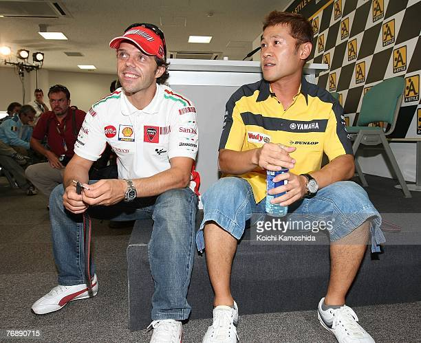 Loris Capirossi of Italy and the Ducati Marlboro team and Makoto Tamada of Japan and Dunlop Yamaha attend a press conference during the buildup for...