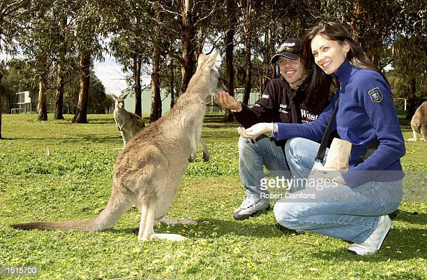 Loris Capirossi of Italy and the West Honda Pons Race Team feeds the kangaroos with his wife Ingrid at the Phillip Island Wild Life Park in...
