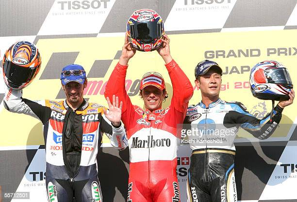 Loris Capirossi of Italy Makoto Tamada of Japan and Max Biaggi of Italy celebrate after winning the Japanese MotoGP at the Motegi Twin Ring curcuit...