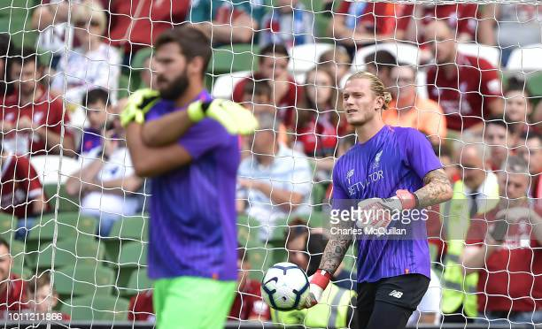 Loris Karius and Alisson Becker of Liverpool during the international friendly game between Liverpool and Napoli at Aviva Stadium on August 4 2018 in...