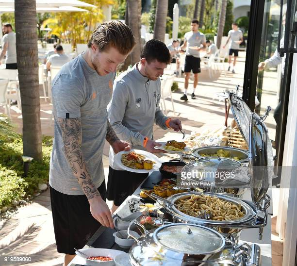 Loris Karius and Andrew Robertson of Liverpool preparing lunch after a training session at Marbella Football Center on February 17 2018 in Marbella...