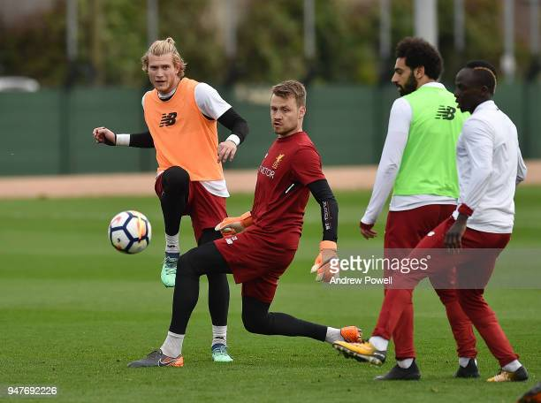 Loris Karius and Simon Mignolet of Liverpool during a training session at Melwood Training Ground on April 17 2018 in Liverpool England