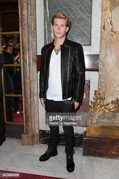 Loris Karius attends the Balmain Menswear Spring/Summer 2017 show as part of Paris Fashion Week on June 25, 2016 in Paris, France.
