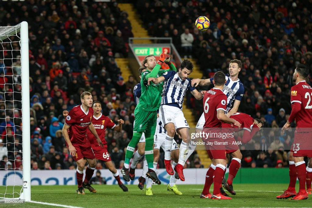 Loris Karius of Liverpool and Claudio Jacob of West Bromwich Albion during the Premier League match between Liverpool and West Bromwich Albion at Anfield on December 13, 2017 in Liverpool, England.