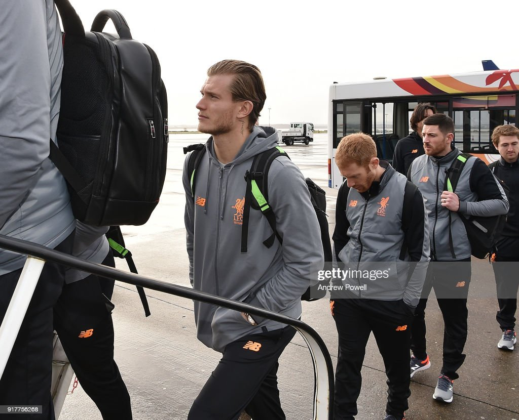 Loris Karius of Liverpool board the plane for their trip to Porto at Liverpool John Lennon Airport on February 13, 2018 in Liverpool, England.