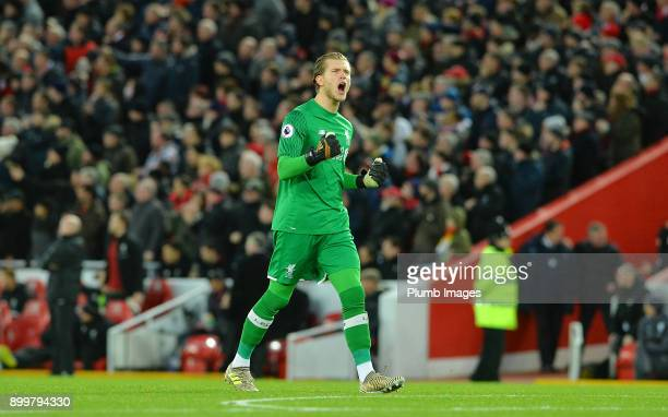 Loris Karius of Liverpool celebrates Mohamed Salah's equaliser during the Premier League match between Liverpool and Leicester City at Anfield on...