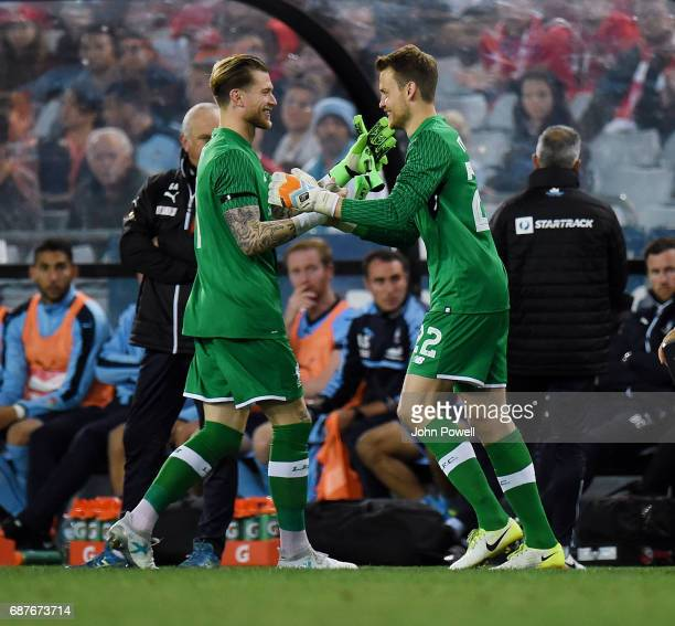 Loris Karius of Liverpool comes off for Simon Mignolet during the International Friendly match between Sydney FC and Liverpool FC at ANZ Stadium on...