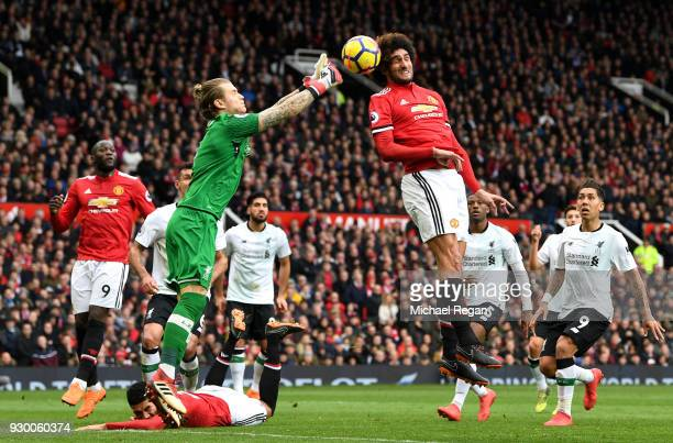 Loris Karius of Liverpool competes for the ball with Marouane Fellaini of Manchester United during the Premier League match between Manchester United...