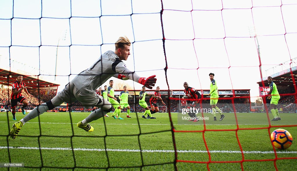 Loris Karius of Liverpool dives in vaine as as Steve Cook of AFC Bournemouth (C) scores their third goal during the Premier League match between AFC Bournemouth and Liverpool at Vitality Stadium on December 4, 2016 in Bournemouth, England.