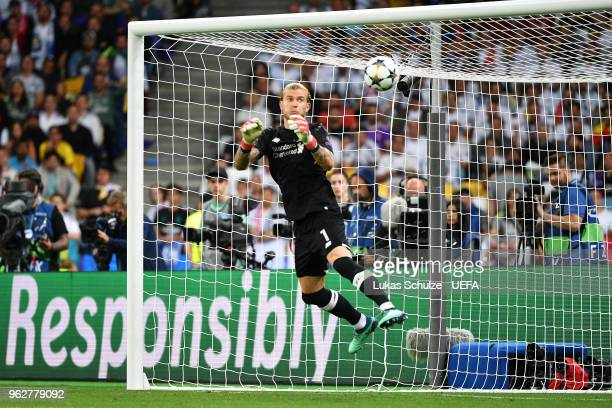Loris Karius of Liverpool fumbles the ball as he concedes for the third time during the UEFA Champions League Final between Real Madrid and Liverpool...