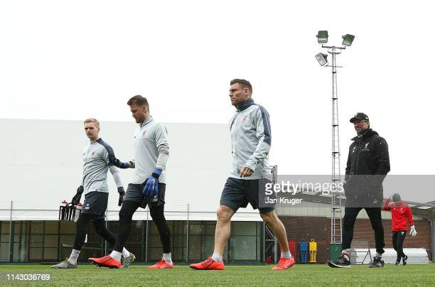 Loris Karius of Liverpool James Milner of Liverpool and Jurgen Klopp Manager of Liverpool walk out prior to the Liverpool training session on the eve...