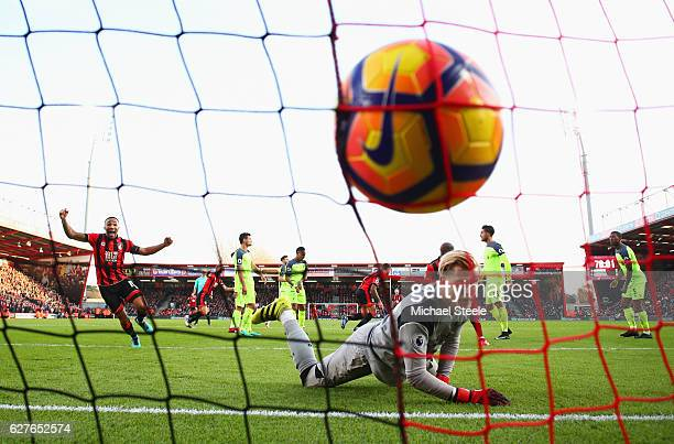 Loris Karius of Liverpool looks dejected as Callum Wilson of AFC Bournemouth celebrates as Steve Cook of AFC Bournemouthscores their third goal...
