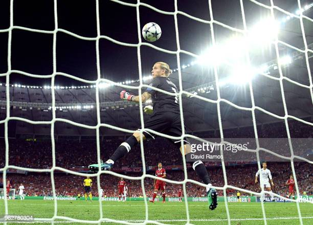 Loris Karius of Liverpool watches the ball cross the line as he concedes for the third time during the UEFA Champions League Final between Real...