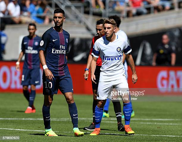 Loris Zonta of FC Internazionale and Javier Pastore of PSG compete during the International Champions Cup 2016 match between FC Internazionale and...