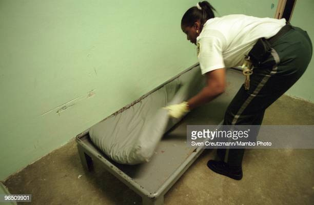 Lorita Burnside Corporal in the Miami Women Detention Center prepares the bed in cell the cell where Gregory Hemingway died on September 24 in Miami...