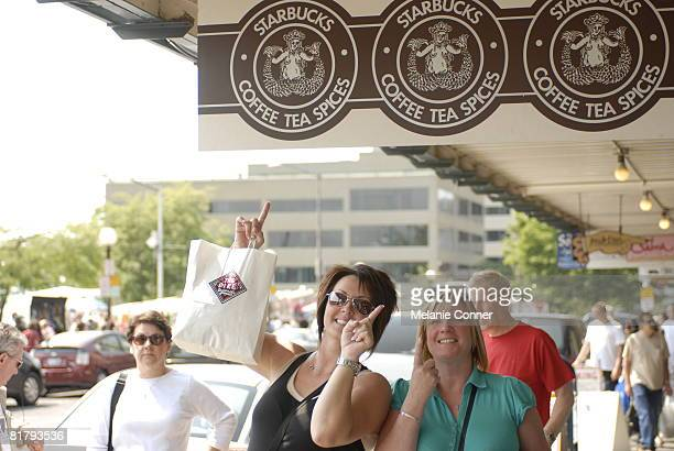 Lorna Brown of Alberta Canada and Karen McKay of Scotland pose outside of the flagship Starbucks store at Pike Place July 1 2008 in Seattle...