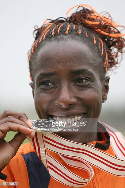 Lornah Kiplagat of The Netherlands poses with her silver medal after the Women's Long Race at the 34th IAAF World Cross Country Championship on April...