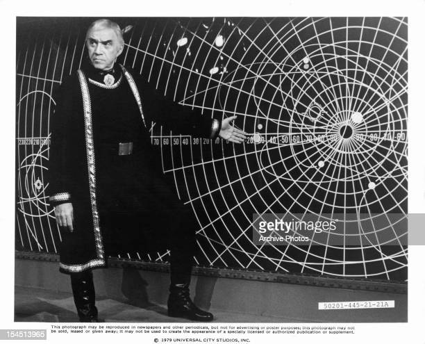 Lorne Greene presents a map in a scene from the television series 'Battlestar Galactica', 1978.