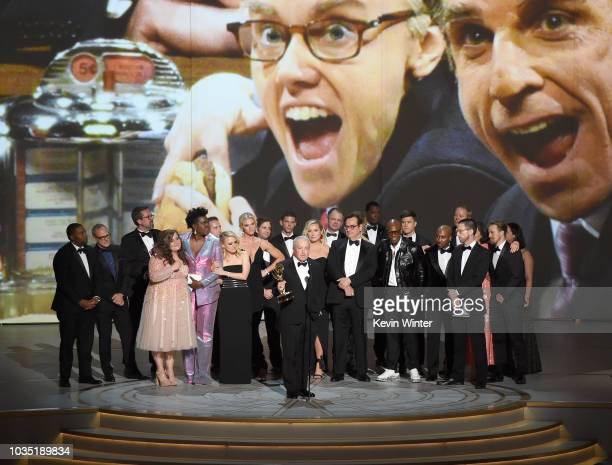 Lorne Michaels and cast and crew accepts the Outstanding Variety Sketch Series award for 'Saturday Night Live' onstage during the 70th Emmy Awards at...