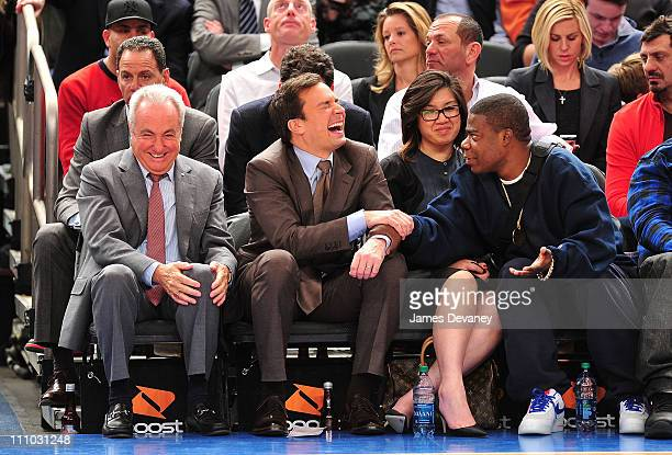 Lorne Michaels Jimmy Fallon guest and Tracy Morgan attend the Orlando Magic vs New York Knicks game at Madison Square Garden on March 28 2011 in New...