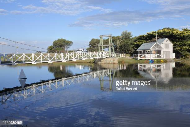 lorne swing bridge and boathouse in victoria australia - rafael ben ari stock pictures, royalty-free photos & images
