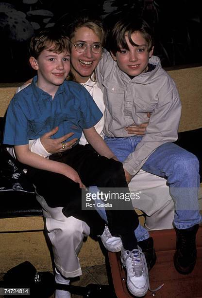 Lorraine Bracco Joseph Mazzello and Elijah Wood at the Planet Hollywood in New York City New York