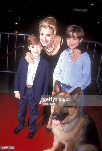 Lorraine Bracco Joseph Mazzello Elijah Wood with Shane the dog at the premiere for Radio Flyer in Los Angeles on February 20 1992