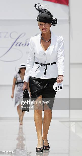 Lorraine Cookson of Karaka walks down the catwalk during the Fashion in the Field at the New Zealand Herald Christmas Carnival Boxing Day races at...