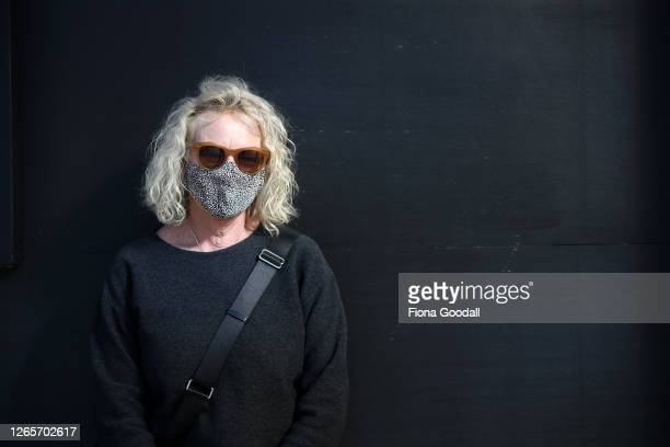 Lorraine Hammond of Ponsonby is seen wearing a homemade mask from an unused silk shirt on August 13 2020 in Auckland New Zealand COVID19 restrictions...