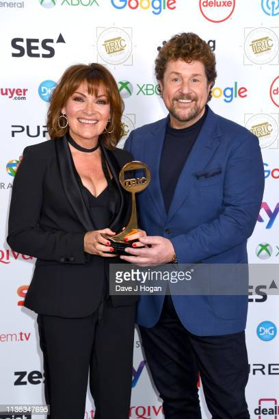 Lorraine Kelly and Michael Ball pose with the Special Award during the 2019 'TRIC Awards' held at The Grosvenor House Hotel on March 12 2019 in...